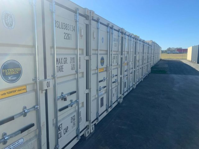 A line of BJS Storage 20 foot containers
